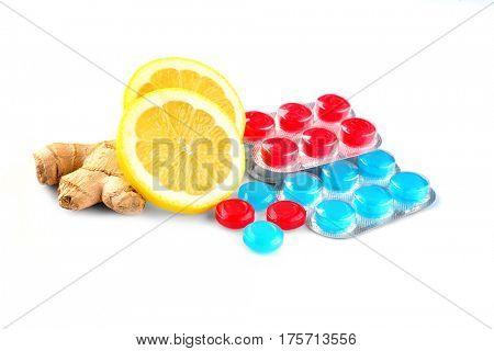 Cough drops with lemon and ginger on white background