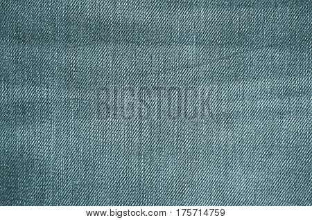 Blue texture of jeans textile close up. Blank backdrop for design. Multicolor background set.