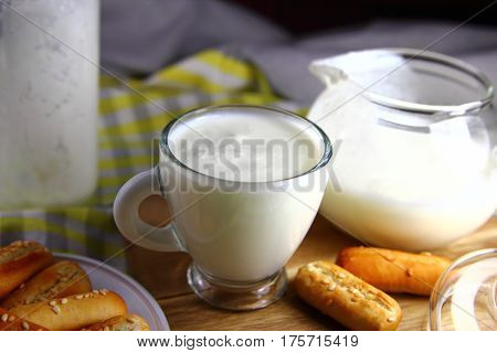 kefir in a Cup with white bread and sesame seeds