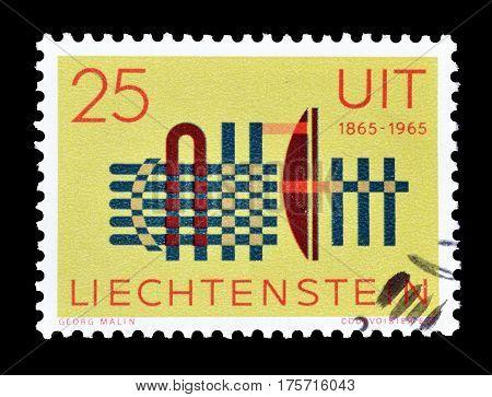 LIECHTENSTEIN - CIRCA 1965 : Cancelled postage stamp printed by Liechtenstein, that shows UIT Emblem.