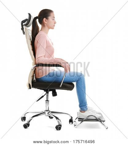 Posture concept. Young woman sitting in armchair against white background