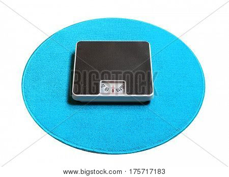 Retro style weighing machine on a blue carpet. Sliming, dieting and healthy lifestyle theme.