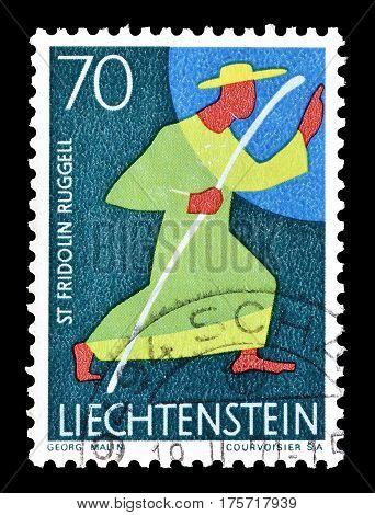 LIECHTENSTEIN - CIRCA 1967 : Cancelled postage stamp printed by Liechtenstein, that shows Saint Fridolin.
