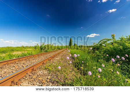 Scenic, old, railroad in remote rural area in spring, in Eastern Europe