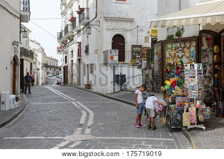 Monte Sant'Angelo Italy - 28 June 2016: people shopping on the tourist shops of Monte Sant'Angelo on Puglia Italy.