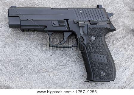 pistol or hand gun 9 mm  on wood table