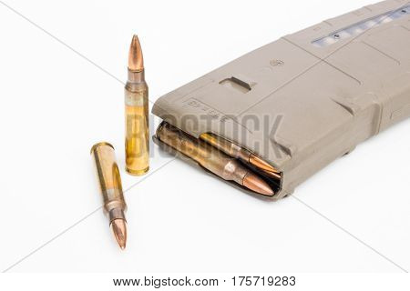 isolated bullet magazine and rifle bullet 5.56mm