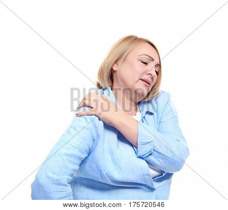 Senior woman suffering from pain in shoulder, on white background