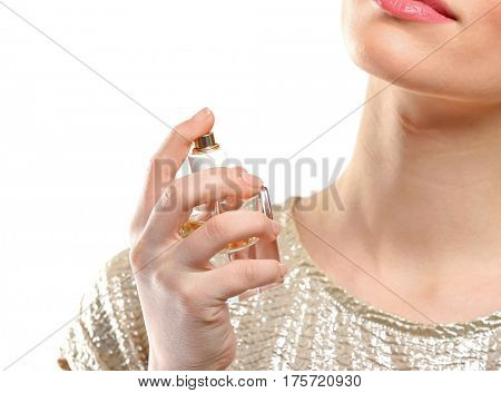 Beautiful young woman with bottle of perfume on white background, closeup