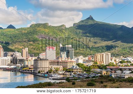 Port Louis Mauritius - December 12 2015: A Visit to Mauritius - Port Louis Embankment city and mountains. Blue Penny museum downstairs in the center.