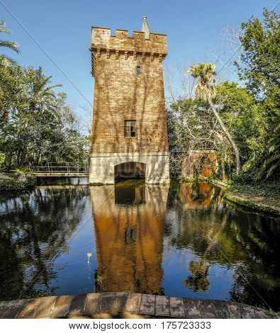 Castle of the lake with its elevated bridge in Park Can Soley Badalona Barcelona Spain