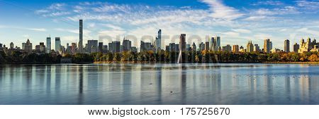 Morning panoramic view of the Central Park Reservoir and Midtown Manhattan skyscrapers in Fall. New York City