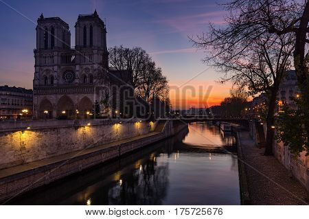 Notre Dame de Paris cathedral at sunrise with the Seine River. Ile de La Cite. 4th Arrondissement Paris France