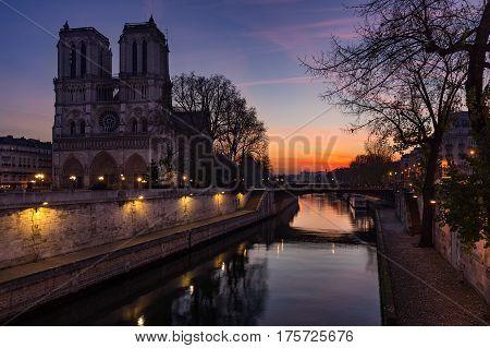 Notre Dame de Paris cathedral at sunrise with the Seine River. Ile de La Cite. 4th Arrondissement Paris France