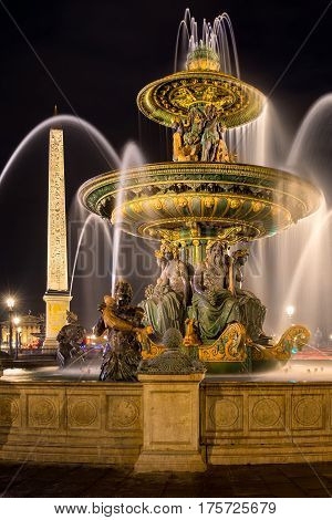 The Fountain of River Commerce and Navigation (Fontaine des Fleuves) and the obelisk at night. Place de la Concorde Paris France