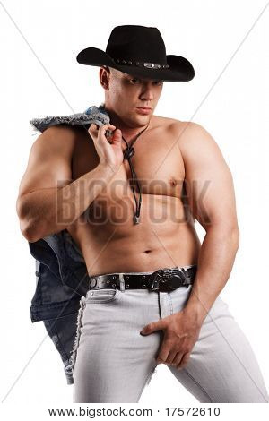 A muscular man in a cowboy hat. Isolated on white.