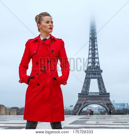 Woman Against Eiffel Tower In Paris, France Looking Aside