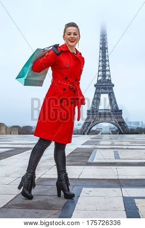 Woman Against Eiffel Tower In Paris, France With Shopping Bag