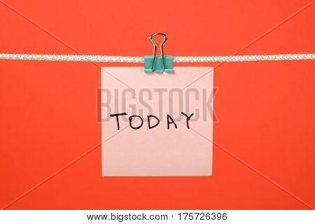 Pink Paper Note Hanging On The String With Text Today