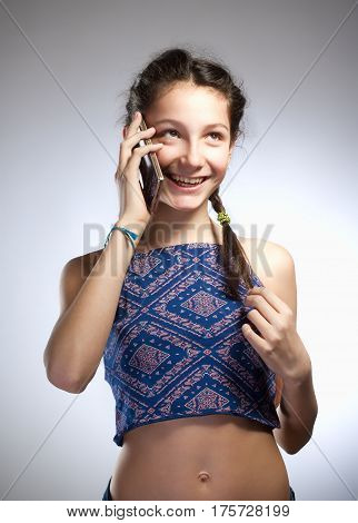 Preadolescent Girl with Braid Talking on the Phone