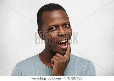 I Have An Idea. Headshot Of Handsome African Male Dressed Casually, Exclaiming, Holding Finger On Hi