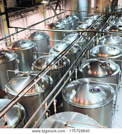 Metal shiny tanks for fermentation and beer fermentation. Shop brewery.
