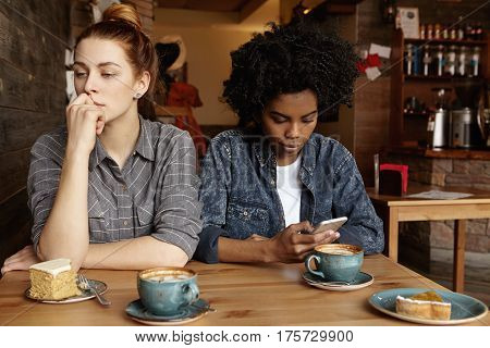 Homosexual Relationships And Modern Technologies. Beautiful Redhead Girl Having Worried Look, Sittin