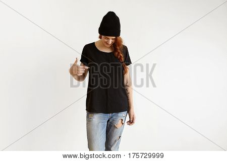 Clothing, Design And Advertising Concept. Studio Shot Of Fashionable Young Ginger Caucasian Female W