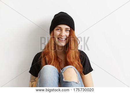 Fashionable Female Teenager Wearing Her Messy Ginger Hair Loose Relaxing Indoors, Sitting At White W