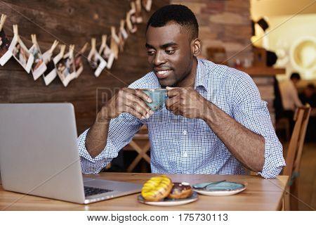 Handsome Young African American Office Worker Wearing Formal Shirt Holding Mug, Enjoying Coffee Duri