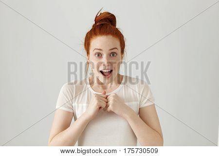 Portrait Of Happy Excited Young Woman With Ginger Hair Screaming Or Exclaiming, Opening Mouth Widely