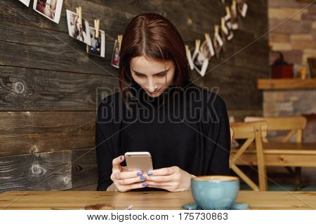 Pretty Girl Sitting At Cafe Table With Mug, Using Wireless Internet Connection On Mobile Phone, Mess