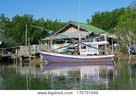 Shack and a traditional fishermen's sailing boat