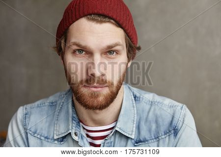 Close Up Indoor Shot Of Attractive Caucasian Young Male In Stylish Clothing Posing Isolated At Moder