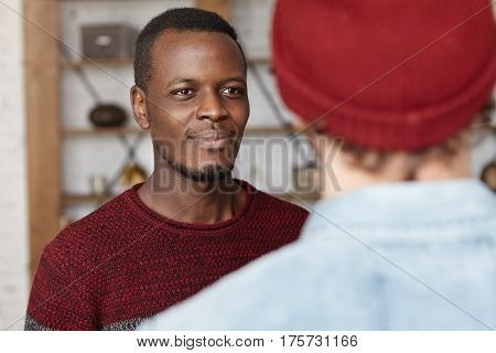 Happy Attractive African American Young Man Smiling Cheerfully While Having Good Conversation With U