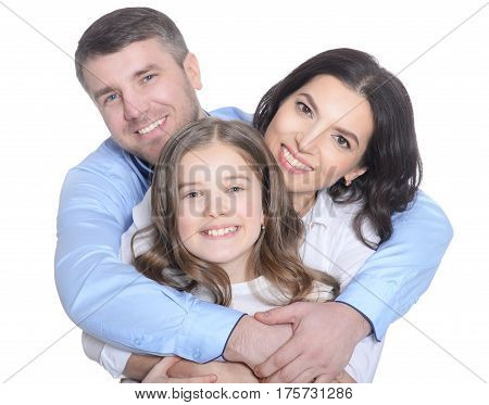 Portrait of a happy young family on a white background