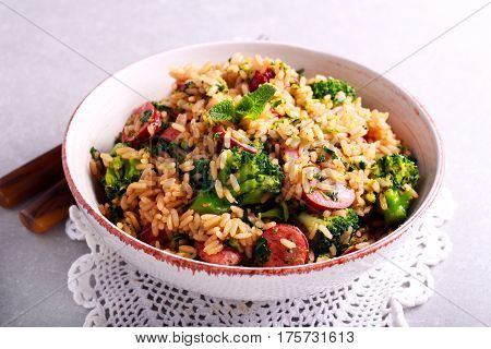 Broccoli sausage and rice casserole on plate