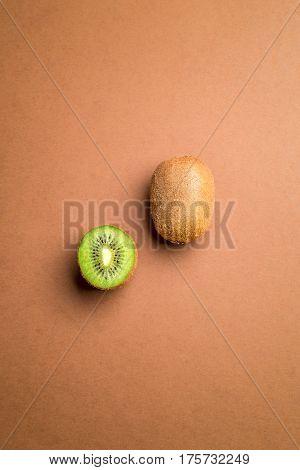 Kiwi fruit on brown background.Useful for food background