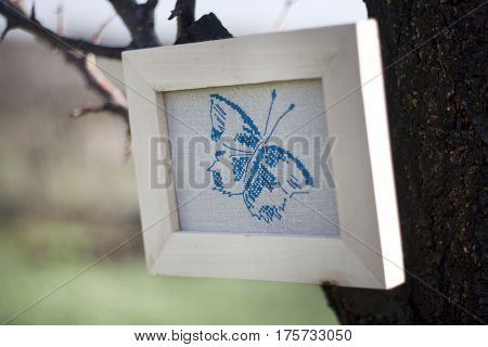 butterfly cross stitch embroidered folk style outdoors