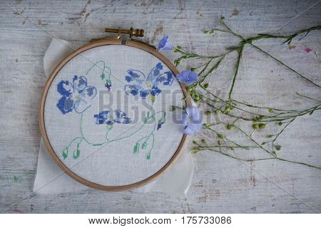 beautiful wild flower embroidered cross-stitch in the Hoop rustic still life