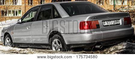 Kazakhstan, Ust-Kamenogorsk, 28 february 2017: Audi A6, gray car, back view, abandoned car