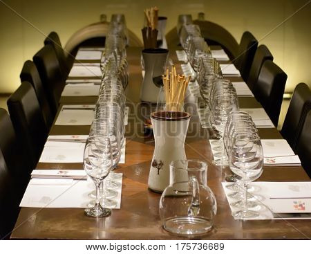 A closeup of a tasting table in a winery