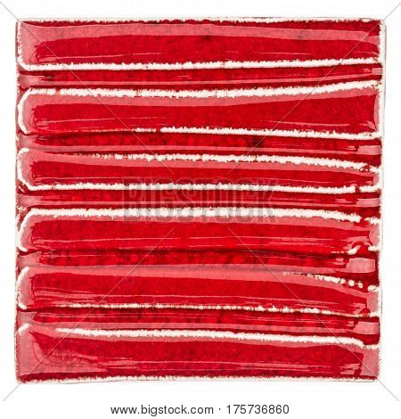 Red lined handmade glazed ceramic tile isolated on white background
