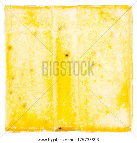 Yellow lined handmade glazed ceramic tile isolated on white background