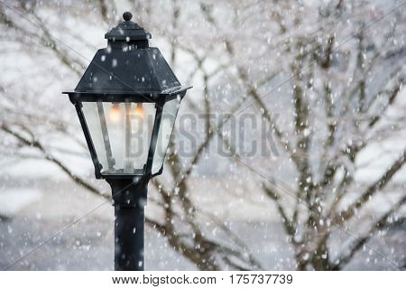A gas lamppost gives light during a snowfall in Central New Jersey.