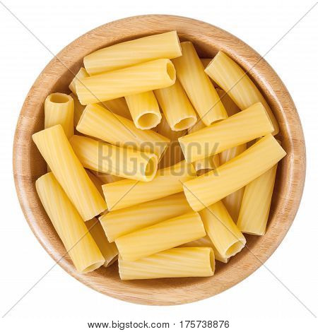 Rigatoni pasta in wooden bowl isolated on white background