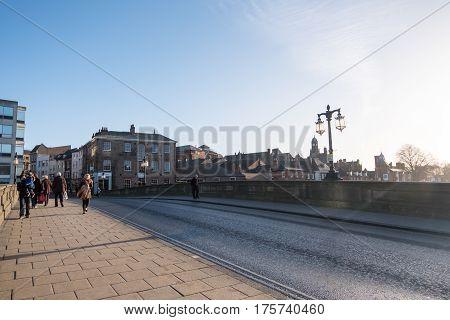 York, United Kingdom. 4 January 2017 : People Walking On The Bridge. River Ouse, York, England