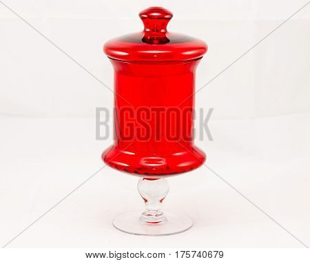 a tall red glass jar or center piece