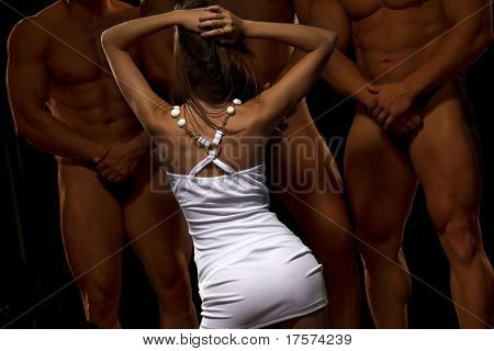 Rear view of beautiful young woman against three athletes, bowing their heads respectfully before her
