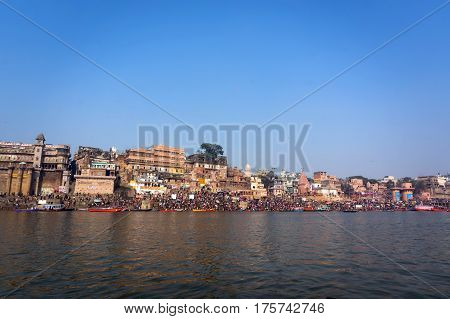 Varanasi city landscape - view from the Ganga river India morning city river view ancient city landscape Indian city on Ganges Varanasi river trip clean blue water of Ganges river reflections